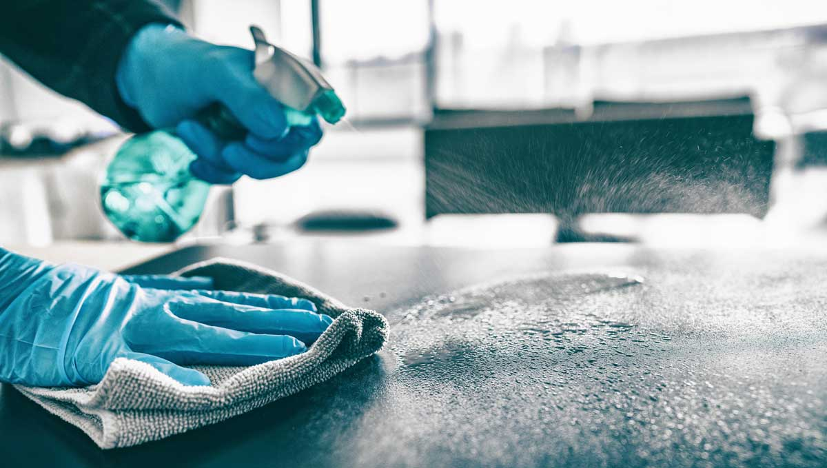 Girl-With-Gloves-Disinfecting-A-Table-Coronavirus-Disinfecting-Services