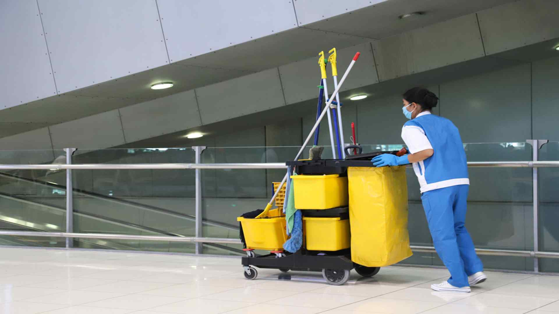 Lady With Cleaning Supplies In Office Building-Commercial Cleaning-